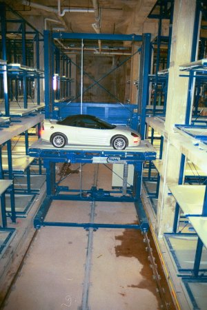 To retrieve the vehicle the card is again read and the process starts with the car delivered to the entry/exit area on the turntable this time facing the ... & Space Saver Parking Company